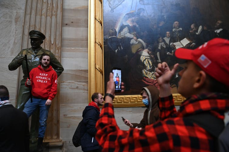 Many of the people who broke into the U.S. Capitol building on Jan. 6 carried cellphones, which can be tracked, and posted photos of their activities on social media. Photo by Saul Loeb/AFP via Getty Images